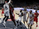 Real Madrid's Andres Nocioni (L) blocks a shot from Olympiakos' Bryant Dunston (2ndL) during their Euroleague Final Four final basketball game in Madrid, Spain, May 17, 2015.  REUTERS/Sergio Perez      TPX IMAGES OF THE DAY